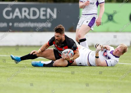 Jarrod Sammut of London Broncos with a try despite the tackle from Kieran Gill of Newcastle Thunder; Rosslyn Park, London, England; Betfred Championship, Rugby League, London Broncos versus Newcastle Thunder.
