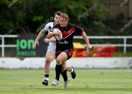 Stock Photo of Greg Richards of London Broncos running to score a try; Rosslyn Park, London, England; Betfred Championship, Rugby League, London Broncos versus Newcastle Thunder.