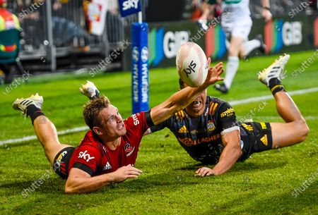 Crusaders vs Chiefs. Crusaders' George Bridge hits the ball dead from Anton Lienert-Brown of the Chiefs