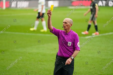 Mike Dean (Referee) shows a yellow card during the EFL Sky Bet Championship match between Derby County and Sheffield Wednesday at the Pride Park, Derby