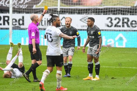 Sheffield Wednesday midfielder Kadeem Harris (7) is booked and receives a caution and a yellow card by Mike Dean (Referee) during the EFL Sky Bet Championship match between Derby County and Sheffield Wednesday at the Pride Park, Derby
