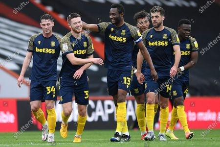 Will Forrester of Stoke City second left is congratulated on scoring the first goal by Mikel John Obi of Stoke City during AFC Bournemouth vs Stoke City, Sky Bet EFL Championship Football at the Vitality Stadium on 8th May 2021
