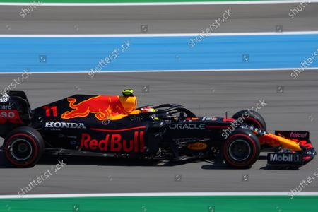 Red Bull driver Sergio Perez of Mexico steers his car during the qualifying for the Spanish Formula One Grand Prix at the Barcelona Catalunya racetrack in Montmelo, just outside Barcelona, Spain, . The Spanish Grand Prix will be held on Sunday