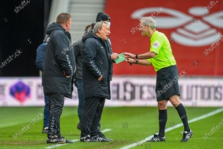YELLOW CARD Referee Martin Atkinson speaks with Middlesbrough Manager, Neil Warnock after he is booked  during the EFL Sky Bet Championship match between Middlesbrough and Wycombe Wanderers at the Riverside Stadium, Middlesbrough