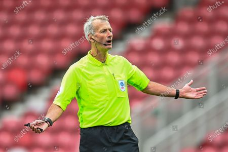 Stock Photo of Referee Martin Atkinson during the EFL Sky Bet Championship match between Middlesbrough and Wycombe Wanderers at the Riverside Stadium, Middlesbrough