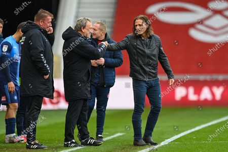 Wycombe Wanderers manager, Gareth Ainsworth (right) pumps fists with Middlesbrough Manager, Neil Warnock  after the final whistle of the EFL Sky Bet Championship match between Middlesbrough and Wycombe Wanderers at the Riverside Stadium, Middlesbrough