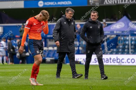 Luton Town Manager Nathan Jones and his assistant Mick Harford leave the field after the EFL Sky Bet Championship match between Queens Park Rangers and Luton Town at the Kiyan Prince Foundation Stadium, London