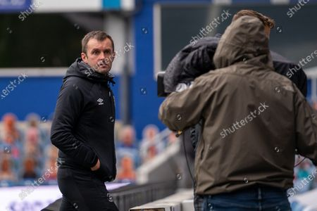 Luton Town Manager Nathan Jones leaves the field after the EFL Sky Bet Championship match between Queens Park Rangers and Luton Town at the Kiyan Prince Foundation Stadium, London