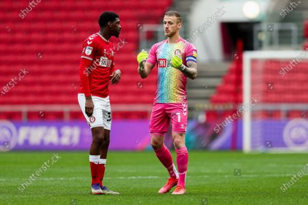Stock Picture of Daniel Bentley of Bristol City gives instructions to Tyreeq Bakinson of Bristol City
