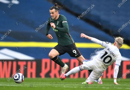 Tottenham's Gareth Bale, left, takes the ball away from Leeds United's Ezgjan Alioski during the English Premier League soccer match between Leeds United and Tottenham Hotspur at Elland Road in Leeds, England