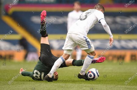 Tottenham's Giovani Lo Celso, left, and Leeds United's Mateusz Klich battle for the ball during the English Premier League soccer match between Leeds United and Tottenham Hotspur at Elland Road in Leeds, England