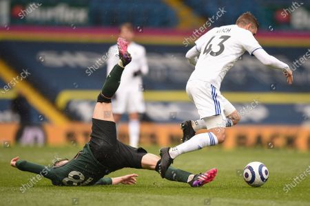 Stock Photo of Tottenham's Giovani Lo Celso, left, and Leeds United's Mateusz Klich battle for the ball during the English Premier League soccer match between Leeds United and Tottenham Hotspur at Elland Road in Leeds, England