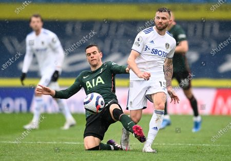 Tottenham's Giovani Lo Celso, left, and Leeds United's Stuart Dallas battle for the ball during the English Premier League soccer match between Leeds United and Tottenham Hotspur at Elland Road in Leeds, England
