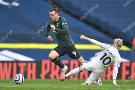 Tottenham's Gareth Bale (L) and Leeds' Ezgjan Alioski (R) in action during the English Premier League soccer match between Leeds United and Tottenham Hotspur in Leeds, Britain, 08 May 2021.