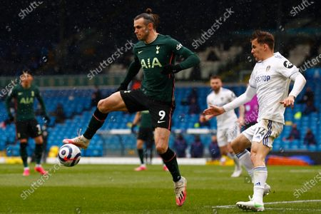 Tottenham's Gareth Bale (L) and Leeds' Diego Llorente (R) in action during the English Premier League soccer match between Leeds United and Tottenham Hotspur in Leeds, Britain, 08 May 2021.