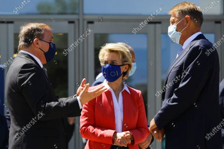 European Commission President Ursula von der Leyen (C) talks with Sweden's Prime Minister Stefan Lofven and Romania's President Klaus Werner Iohannis (R) after a meeting in the framework of the European Social Summit in Porto, Portugal, 08 May 2021.