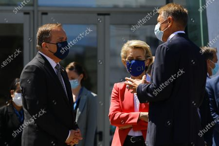 Stock Image of European Commission President Ursula von der Leyen (C) talks with Sweden's Prime Minister Stefan Lofven and Romania's President Klaus Werner Iohannis (R) after a meeting in the framework of the European Social Summit in Porto, Portugal, 08 May 2021.