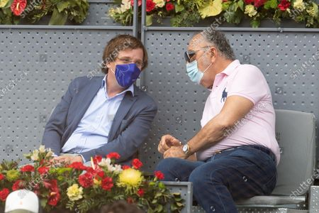 Stock Picture of Madrid's Mayor Jose Luis Martinez-Almeida (L) and Romanian businessman and former tennis player Ion Tiriac (R) watch the semi final match between Dominic Thiem of Austria and Alexander Zverev of Germany at the Mutua Madrid Open tennis ?tournament in Madrid, central Spain, 08 May 2021.