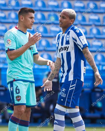 Stock Photo of Oscar Duarte of UD Levante speaks with Deyverson Silva of CD Alaves during the spanish league, LaLiga, football match between CD Alaves v UD Levante at Mendizorrotza Stadium  on 8 May, 2021 in Vitoria, Spain.