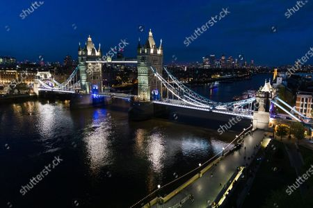 Tower Bridge at night is seen from City Hall on the evening that the Mayor of London, Sadiq Khan, was re-elected as the Mayor of London, at City Hall in London, Britain, 08 May 2021. Britons voted on 06 May 2021 in local and mayoral elections.