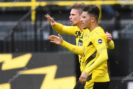 Stock Picture of Dortmund's Jadon Sancho, celebrates after scoring his side's third goal with Dortmund's Lukasz Piszczek, rear, during the German Bundesliga soccer match between Borussia Dortmund and RB Leipzig in Dortmund, Germany