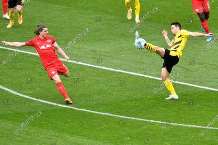 Dortmund's Raphael Guerreiro, right, in action during the German Bundesliga soccer match between Borussia Dortmund and RB Leipzig in Dortmund, Germany