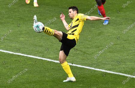 Dortmund's Raphael Guerreiro in action during the German Bundesliga soccer match between Borussia Dortmund and RB Leipzig in Dortmund, Germany, 08 May 2021.