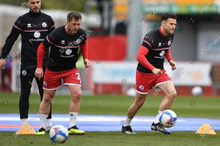 Crawley Town Midfielder Dannie Bulman (21)  and Crawley Town Defender Mark Wright (30)  warming up during the EFL Sky Bet League 2 match between Crawley Town and Bolton Wanderers at The People's Pension Stadium, Crawley