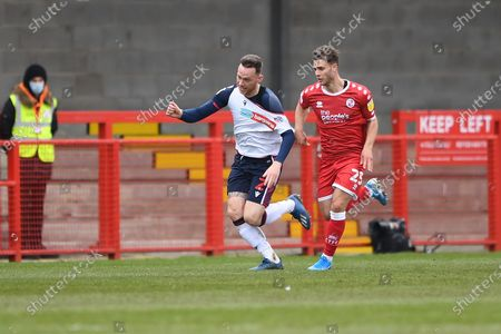 Stock Image of Bolton Wanderers Defender Gethin Jones (2) and Crawley Town Defender Nicholas Tsaroulla (25)  battles for possession during the EFL Sky Bet League 2 match between Crawley Town and Bolton Wanderers at The People's Pension Stadium, Crawley