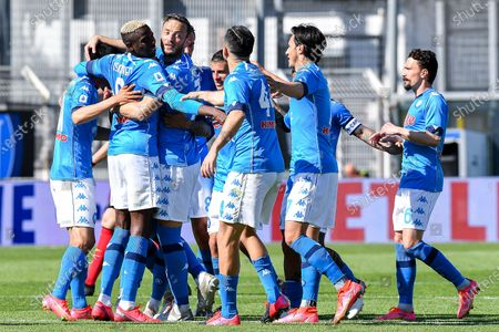 Napoli's Mexican forward Hirving Lozano (left) celebrates with team-mates after scoring a goal during the Italian Serie A soccer match Spezia Calcio vs SSC Napoli at Alberto Picco stadium in La Spezia, Italy, 08 May 2021.