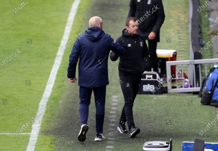 Mark Warburton manager of Queens Park Rangers and Nathan Jones fist bump at the full time whistle during Queens Park Rangers vs Luton Town, Sky Bet EFL Championship Football at The Kiyan Prince Foundation Stadium on 8th May 2021