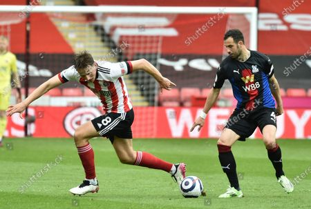 Sheffield United's Sander Berge, right, and Crystal Palace's Luka Milivojevic challenge for the ball during the English Premier League soccer match between Sheffield United and Crystal Palace at Bramall Lane in Sheffield, England