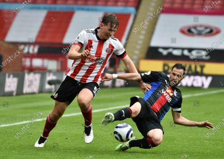 Sheffield United's Sander Berge, left, and Crystal Palace's Luka Milivojevic challenge for the ball during the English Premier League soccer match between Sheffield United and Crystal Palace at Bramall Lane in Sheffield, England