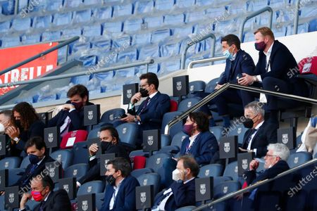 Barcelona's head coach Ronald Koeman, top right, watches from stands during the Spanish La Liga soccer match between FC Barcelona and Atletico Madrid at the Camp Nou stadium in Barcelona, Spain