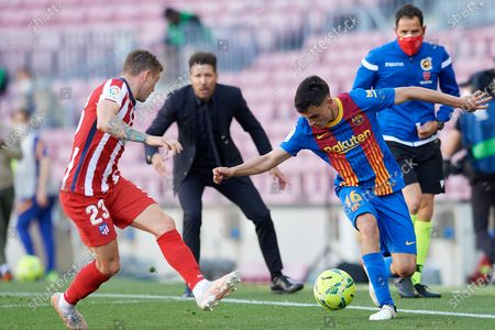 """Pedro Gonzalez """"Pedri"""" of Barcelona and Kieran Trippier of Atletico Madrid compete for the ball during the La Liga Santander match between FC Barcelona and Atletico de Madrid at Camp Nou on May 8, 2021 in Barcelona, Spain. Sporting stadiums around Spain remain under strict restrictions due to the Coronavirus Pandemic as Government social distancing laws prohibit fans inside venues resulting in games being played behind closed doors."""