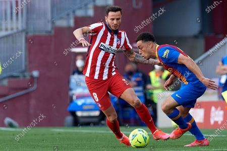Sergiño Dest of Barcelona and Saul Niguez of Atletico Madrid compete for the ball during the La Liga Santander match between FC Barcelona and Atletico de Madrid at Camp Nou on May 8, 2021 in Barcelona, Spain. Sporting stadiums around Spain remain under strict restrictions due to the Coronavirus Pandemic as Government social distancing laws prohibit fans inside venues resulting in games being played behind closed doors.