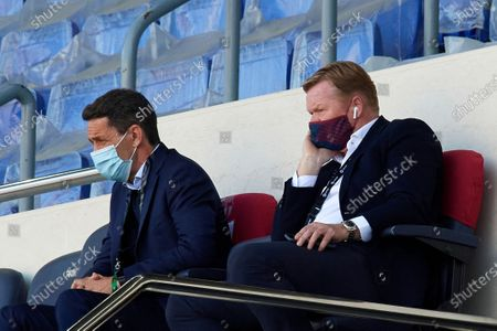 Ronald Koeman head coach of Barcelona sitting on the bench during the La Liga Santander match between FC Barcelona and Atletico de Madrid at Camp Nou on May 8, 2021 in Barcelona, Spain. Sporting stadiums around Spain remain under strict restrictions due to the Coronavirus Pandemic as Government social distancing laws prohibit fans inside venues resulting in games being played behind closed doors.