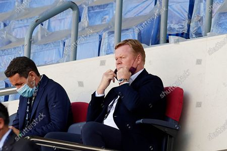 Ronald Koeman, Manager of FC Barcelona sits on the stand prior the La Liga Santander match between FC Barcelona and Atletico de Madrid at Camp Nou on May 8, 2021 in Barcelona, Spain. Sporting stadiums around Spain remain under strict restrictions due to the Coronavirus Pandemic as Government social distancing laws prohibit fans inside venues resulting in games being played behind closed doors.