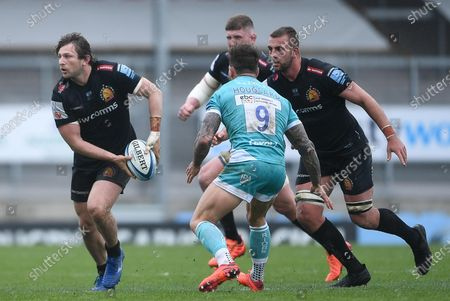 Stock Image of Alec Hepburn of Exeter Chiefs is challenged by Francois Hougaard of Worcester Warriors