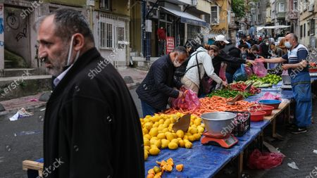 People shopping at local market during the lockdown in Istanbul, Turkey, 08 May 2021. Turkish President Recep Tayyip Erdogan announced a total lockdown between 30 April to 17 May due to increased COVID-19 cases. The lockdown coincides with Eid al-Fitr, which marks the end of the Muslim fasting month of Ramadan.