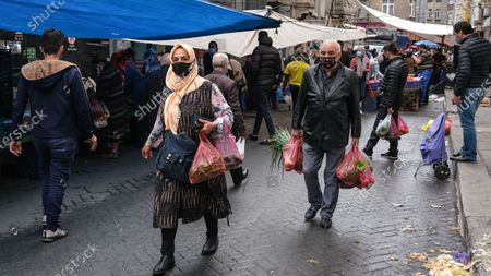 Stock Picture of People shopping at local market during the lockdown in Istanbul, Turkey, 08 May 2021. Turkish President Recep Tayyip Erdogan announced a total lockdown between 30 April to 17 May due to increased COVID-19 cases. The lockdown coincides with Eid al-Fitr, which marks the end of the Muslim fasting month of Ramadan.