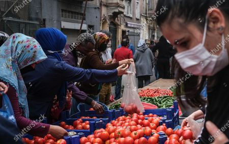Stock Image of People shopping at local market during the lockdown in Istanbul, Turkey, 08 May 2021. Turkish President Recep Tayyip Erdogan announced a total lockdown between 30 April to 17 May due to increased COVID-19 cases. The lockdown coincides with Eid al-Fitr, which marks the end of the Muslim fasting month of Ramadan.