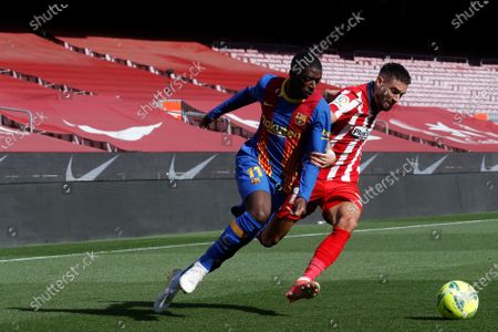 FC Barcelona's winger Ousmane Dembele (L) vies for the ball against Atletico's Yannick Ferreira Carrasco (R) during the Spanish LaLiga soccer match between FC Barcelona and Atletico de Madrid at Camp Nou stadium in Barcelona, Catalonia, Spain, 08 May 2021.