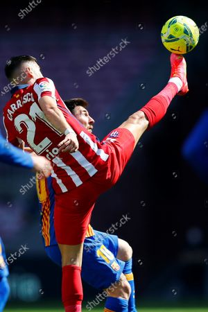 FC Barcelona's Argentinian striker Leo Messi (R) duels for the ball against Atletico's winger Yannick Ferreira Carrasco (L) during the Spanish LaLiga soccer match between FC Barcelona and Atletico de Madrid at Camp Nou stadium in Barcelona, Catalonia, Spain, 08 May 2021.