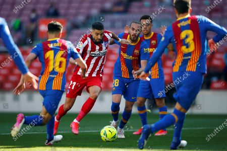Atletico's winger Yannick Ferreira Carrasco (2-L) in action during the Spanish LaLiga soccer match between FC Barcelona and Atletico de Madrid at Camp Nou stadium in Barcelona, Catalonia, Spain, 08 May 2021.
