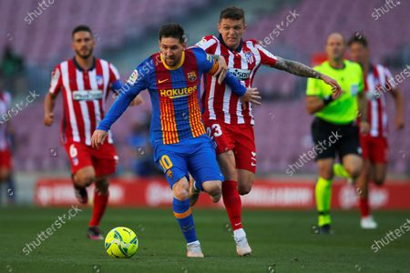FC Barcelona's Argentinian striker Leo Messi (L) vies for the ball against Atletico's defender Kieran Trippier (R) during the Spanish LaLiga soccer match between FC Barcelona and Atletico de Madrid at Camp Nou stadium in Barcelona, Catalonia, Spain, 08 May 2021.