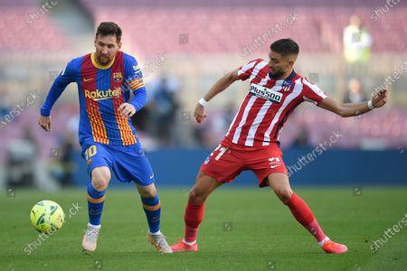 Lionel Messi of FC Barcelona and Yannick Ferreira Carrasco of Atletico de Madrid