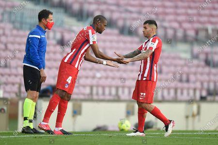 Geoffrey Kondogbia and Angel Correa of Atletico de Madrid