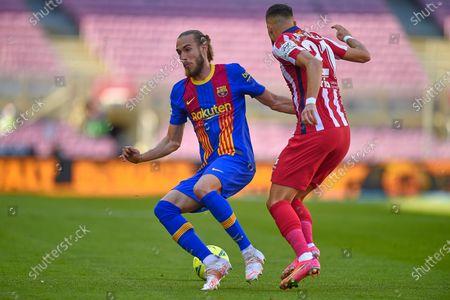 Oscar Mingueza of FC Barcelona and Yannick Ferreira Carrasco of Atletico de Madrid