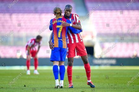 Antoine Griezmann of FC Barcelona and Geoffrey Kondogbia of Atletico de Madrid
